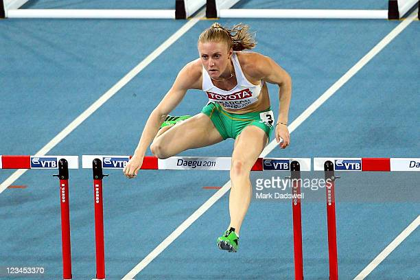 Sally Pearson of Australia hurdles to victory in the women's 100 metres hurdles final during day eight of 13th IAAF World Athletics Championships at...