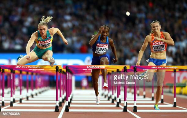 Sally Pearson of Australia Kendra Harrison of the United States and Nadine Visser of the Netherlands compete in the Women's 100 metres hurdles final...