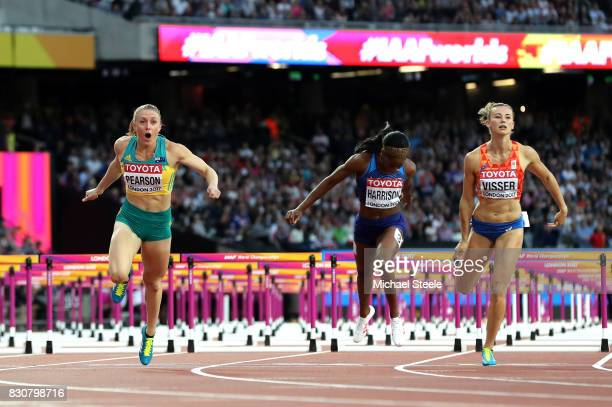 Sally Pearson of Australia leads Kendra Harrison of the United States and Nadine Visser of the Netherlands to the finish line in the Women's 100...