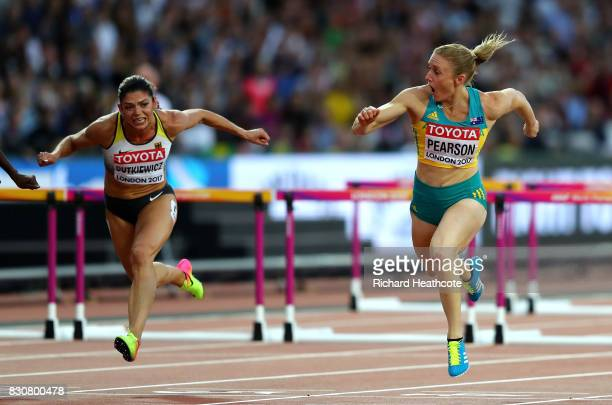 Sally Pearson of Australia leads Pamela Dutkiewicz of Germany to the finish line in the Women's 100 metres hurdles final during day nine of the 16th...