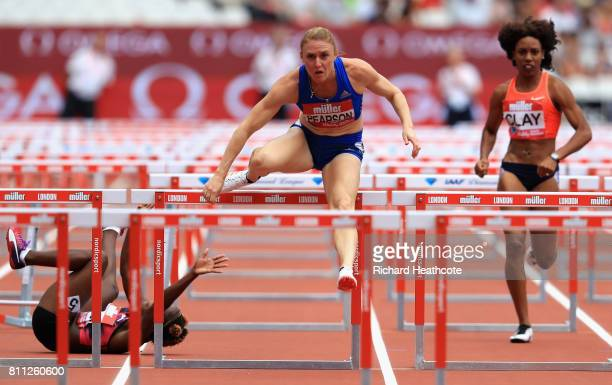 Sally Pearson of Great Britain competes in the Women's 100m hurdles as Megan Simonds of Jamaica falls over during the Muller Anniversary Games at...