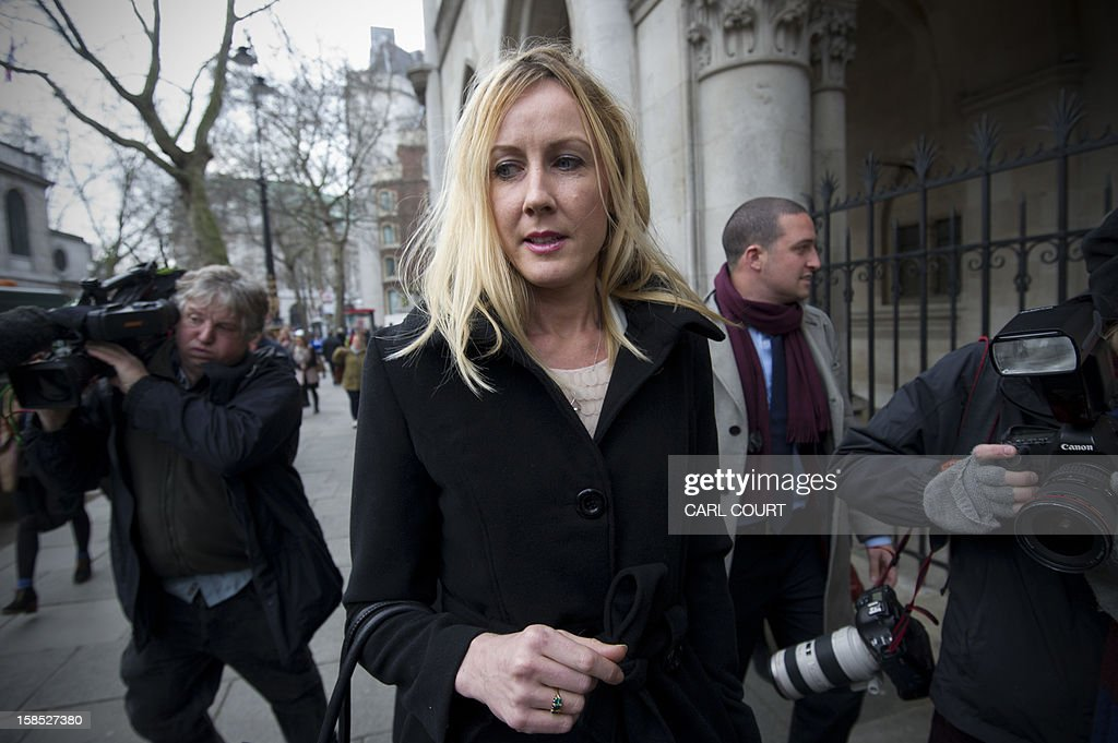 Sally Roberts, the mother of seven-year-old cancer patient Neon, leaves the High Court in central London on December 18, 2012 after a hearing in the legal dispute over Neon's cancer treatment. A judge ruled on December 18 that Neon Roberts could undergo more surgery despite his mother's opposition, which had led her to run away with her son earlier this month. High Court judge David Bodey ruled that Neon, who has already had surgery on a brain tumour, should have another operation after hearing from doctors that he would very likely die soon without treatment.