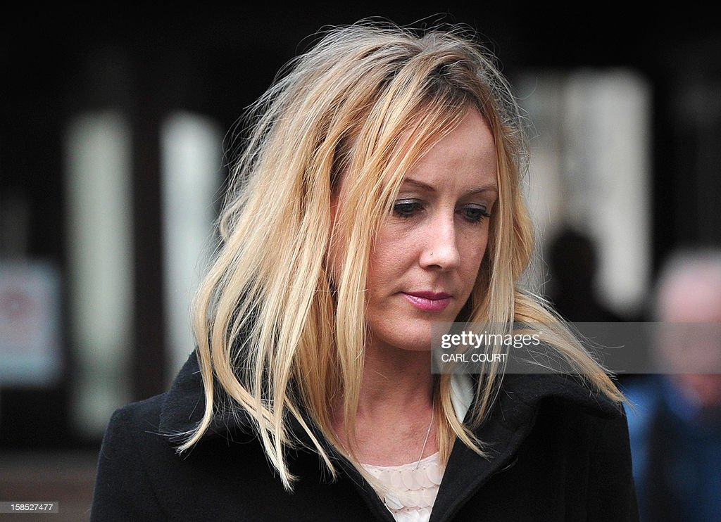 Sally Roberts, the mother of seven-year-old cancer patient Neon, leaves the High Court in central London on December 18, 2012 during a break in the hearing in the legal dispute over Neon's cancer treatment. A judge ruled on December 18 that Neon Roberts could undergo more surgery despite his mother's opposition, which had led her to run away with her son earlier this month. High Court judge David Bodey ruled that Neon, who has already had surgery on a brain tumour, should have another operation after hearing from doctors that he would very likely die soon without treatment. AFP PHOTO / CARL COURT