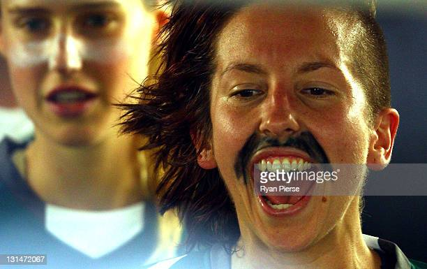 Sally Shippard of Canberra wears a drawn on moustache in support of Movember during the round three WLeague match between Sydney FC and Canberra...