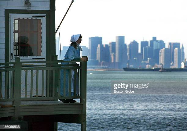Sally Snowman is the first woman to ever serve as light keeper at Boston Light Here she stands on the back deck of the light keepers house which...