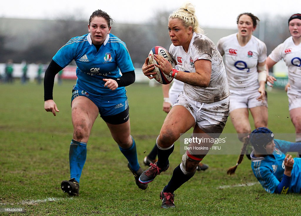 Sally Tunson of England attacks during the Women's RBS Six Nations match between England and Italy at Esher Rugby Club on March 09, 2013 in Esher, England.
