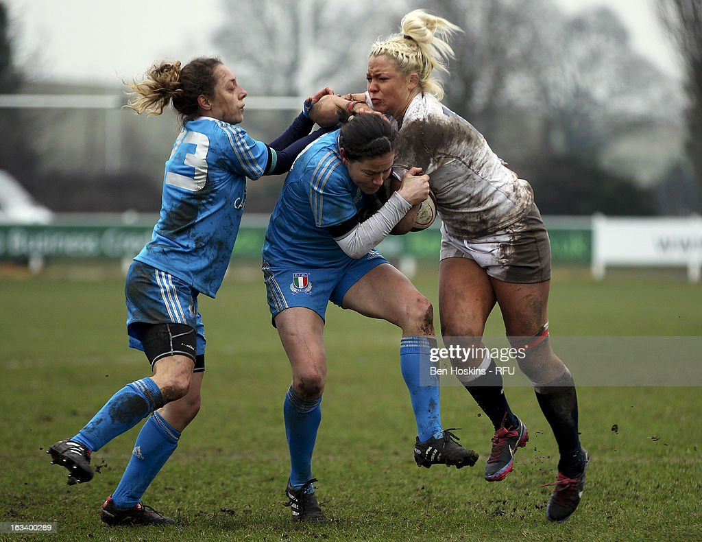 Sally Tunson of England is tackled during the Women's RBS Six Nations match between England and Italy at Esher Rugby Club on March 09, 2013 in Esher, England.