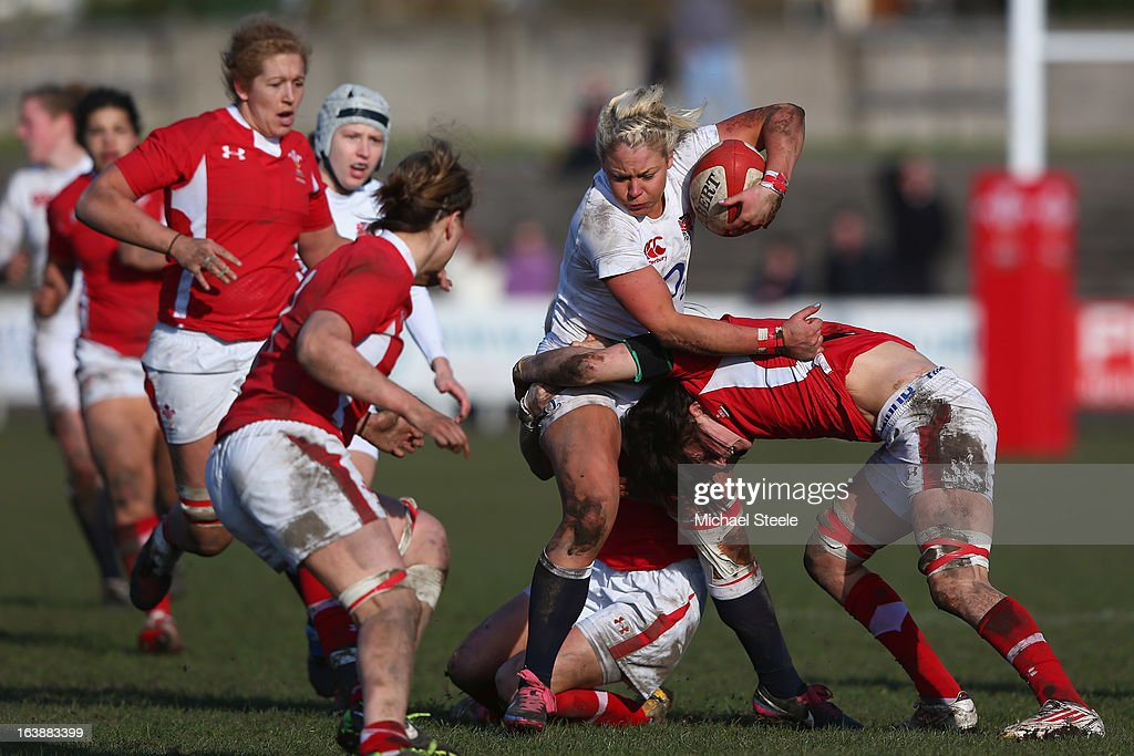 Sally Tuson of England is tackled during the Wales v England Womens Six Nations match at the Talbot Athletic Ground on March 17, 2013 in Port Talbot, Wales.