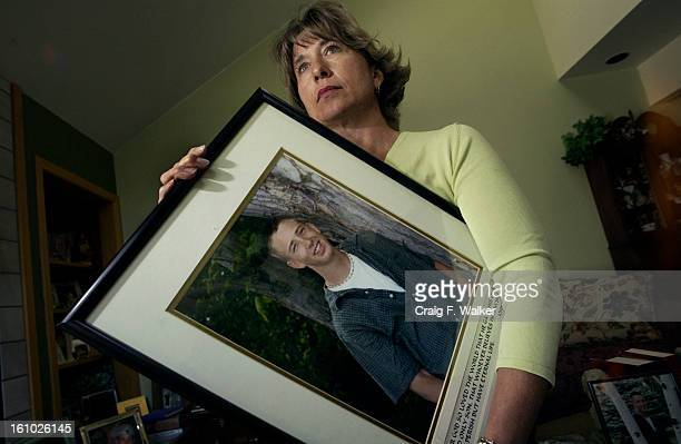COLLINS SEPTEMBER 23 2004 Sally Webster <cq> holds a photograph of her son Taylor while posing for a portrait at her home in Fort Collins CO Taylor...