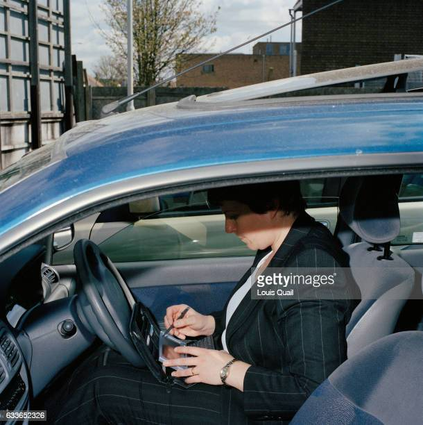 Sally Williams drinks promotions and sales coordinator for GSK products working in Maidstone She is photographed in a car park checking her diary...