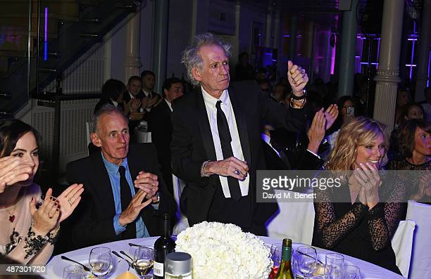 Sally Wood James Fox Keith Richards and Patti Hansen attend the GQ Men Of The Year Awards at The Royal Opera House on September 8 2015 in London...