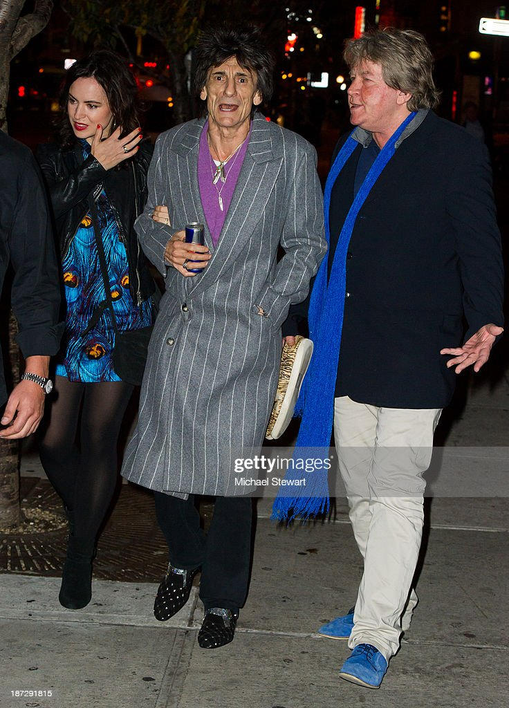 Sally Wood with musicians Ronnie Wood and Mick Taylor of the Rolling Stones seen outside the Gansevoort Hotel on November 7, 2013 in New York City.