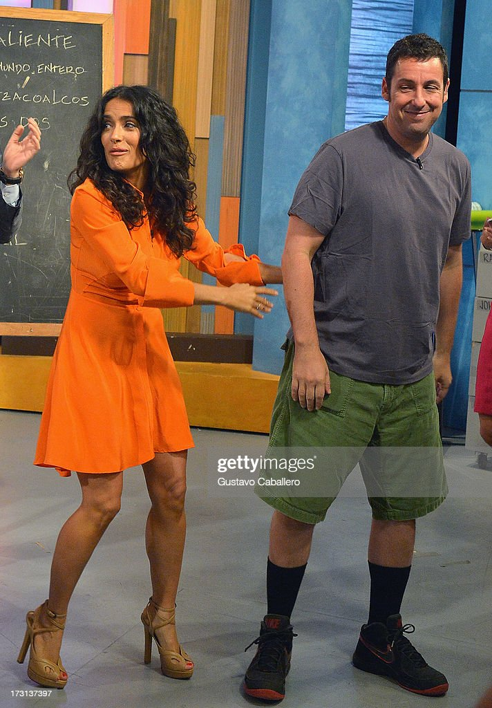<a gi-track='captionPersonalityLinkClicked' href=/galleries/search?phrase=Salma+Hayek&family=editorial&specificpeople=201844 ng-click='$event.stopPropagation()'>Salma Hayek</a> and <a gi-track='captionPersonalityLinkClicked' href=/galleries/search?phrase=Adam+Sandler&family=editorial&specificpeople=202205 ng-click='$event.stopPropagation()'>Adam Sandler</a> of 'Grown Ups 2' cast appears on Univisions 'Despierta America' to promote the movie at Univision Headquarters on July 8, 2013 in Miami, Florida.
