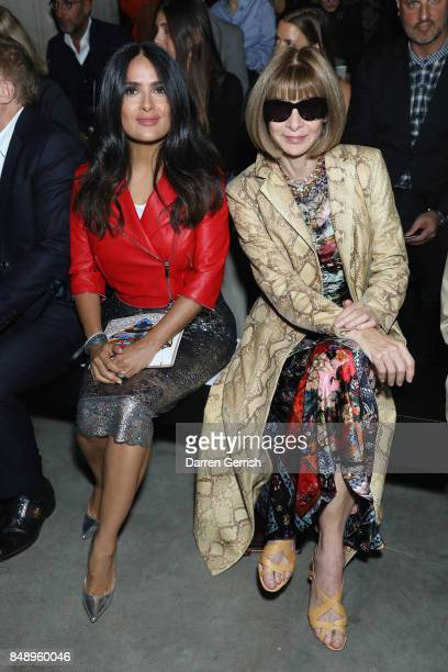 Salma Hayek and Anna Wintour attend the Christopher Kane show during London Fashion Week September 2017 on September 18 2017 in London England
