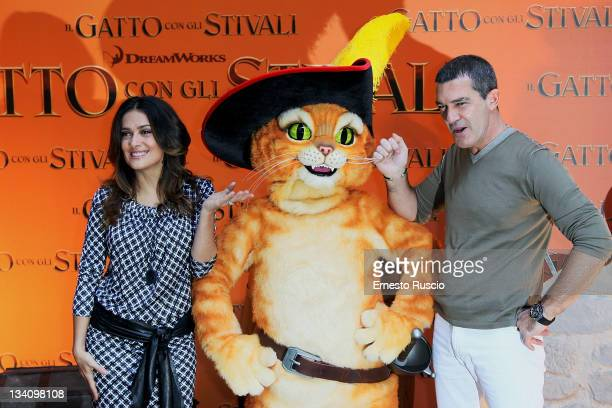 Salma Hayek and Antonio Banderas attend the 'Puss in Boots' photocall at Hotel Hassler on November 25 2011 in Rome Italy