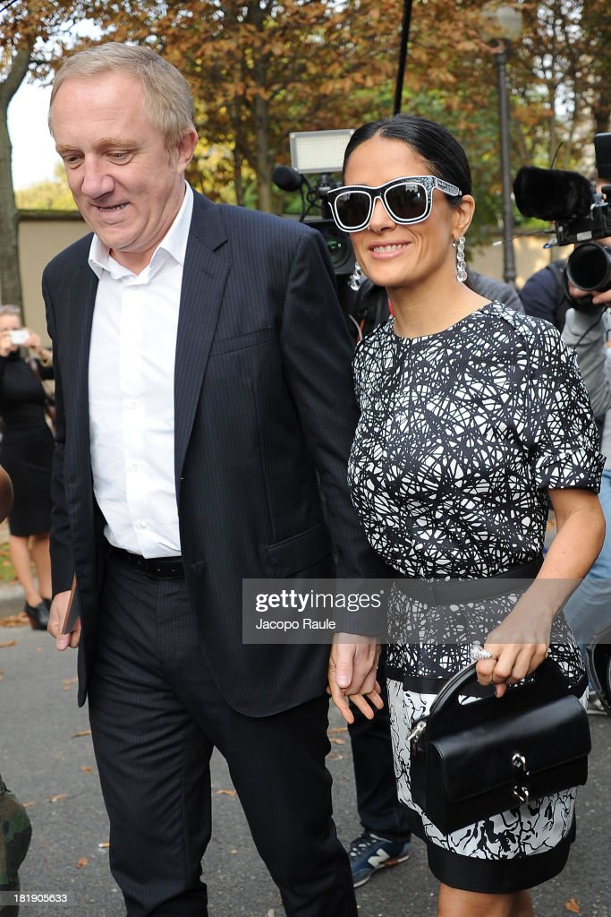 <a gi-track='captionPersonalityLinkClicked' href=/galleries/search?phrase=Salma+Hayek&family=editorial&specificpeople=201844 ng-click='$event.stopPropagation()'>Salma Hayek</a> (R) and <a gi-track='captionPersonalityLinkClicked' href=/galleries/search?phrase=Francois-Henri+Pinault&family=editorial&specificpeople=532174 ng-click='$event.stopPropagation()'>Francois-Henri Pinault</a> arrive at the Balenciaga fashion show during Paris Fashion Week - Womenswear SS14 - Day 3 on September 26, 2013 in Paris, France.