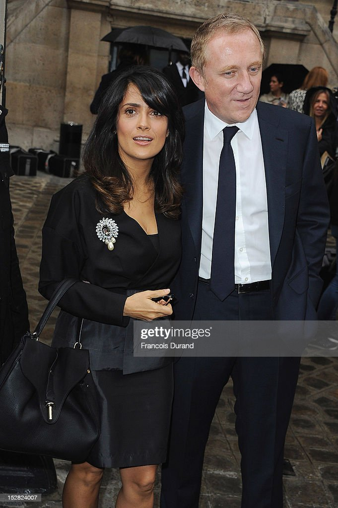 <a gi-track='captionPersonalityLinkClicked' href=/galleries/search?phrase=Salma+Hayek&family=editorial&specificpeople=201844 ng-click='$event.stopPropagation()'>Salma Hayek</a> and Francois-Henri Pinault arrive at the Balmain Spring / Summer 2013 show as part of Paris Fashion Week at Grand Hotel Intercontinental on September 27, 2012 in Paris, France.