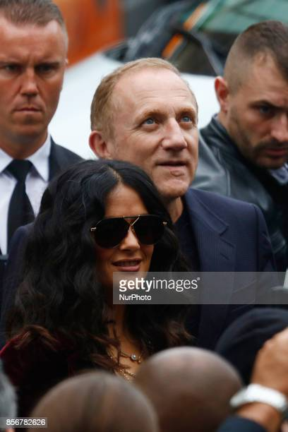 Salma Hayek and FrancoisHenri Pinault arrive to the Stella Mcartney fashion show in Paris France on October 22017