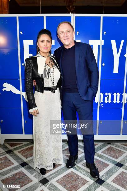 Salma Hayek and FrancoisHenri Pinault attend FENTY PUMA by Rihanna Fall / Winter 2017 Collection at Bibliotheque Nationale de France on March 6 2017...