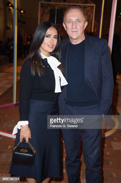 Salma Hayek and FrancoisHenri Pinault attend the Alexander McQueen show as part of the Paris Fashion Week Womenswear Spring/Summer 2018 on October 2...