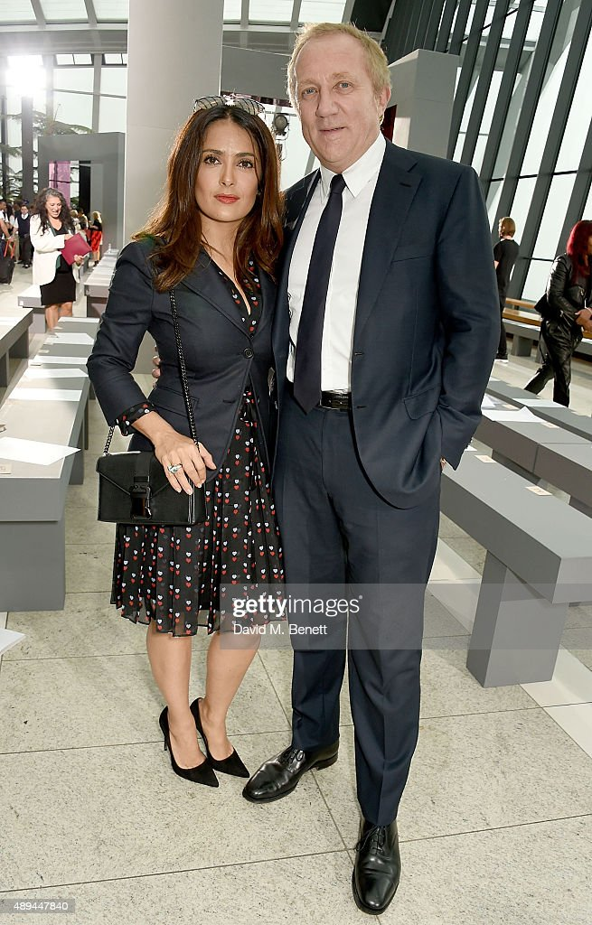 Salma Hayek and Francois-Henri Pinault attend the Christopher Kane show during London Fashion Week SS16 at Sky Garden on September 21, 2015 in London, England.