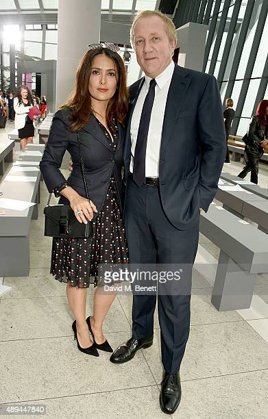 Salma Hayek and FrancoisHenri Pinault attend the Christopher Kane show during London Fashion Week SS16 at Sky Garden on September 21 2015 in London...