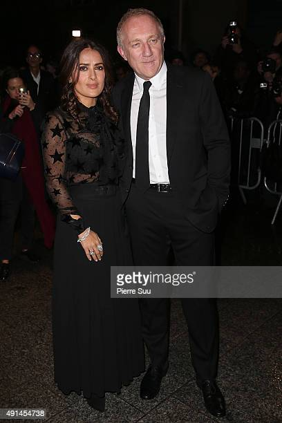 Salma Hayek and FrancoisHenri Pinault attend the Saint Laurent show as part of the Paris Fashion Week Womenswear Spring/Summer 2016 on October 5 2015...