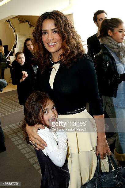 Salma Hayek and her daughter Valentina Paloma Pinault attend the 'Reves d'Enfants' Arop charity event at Opera Bastille on December 15 2013 in Paris...