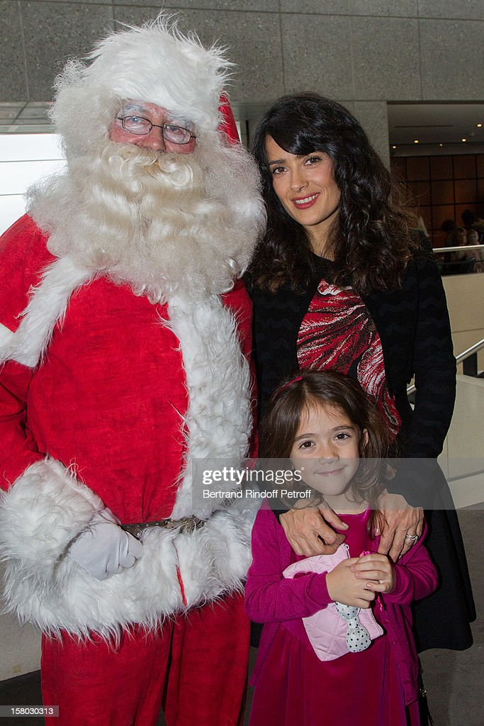 Salma Hayek and her daughter Valentina Paloma Pinault pose before the Don Quichotte Ballet Hosted By 'Reve d'Enfants' Association and AROP at Opera Bastille on December 9, 2012 in Paris, France.