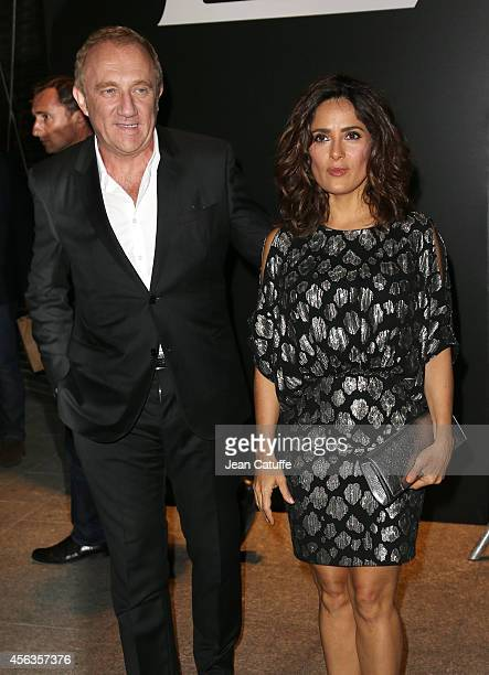Salma Hayek and husband FrancoisHenri Pinault attend the Saint Laurent fashion show at the Carreau du Temple as part of the Paris Fashion Week...