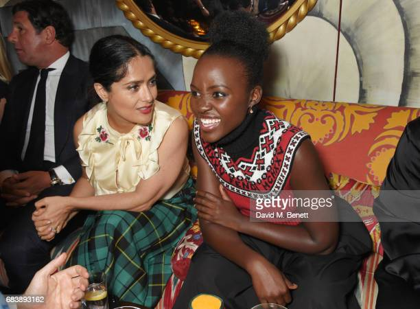 Salma Hayek and Lupita Nyong'o attend the 'Can't Stop Won't Stop A Bad Boy Story' dinner hosted by Sean 'Diddy' Combs Naomi Campbell presented by...