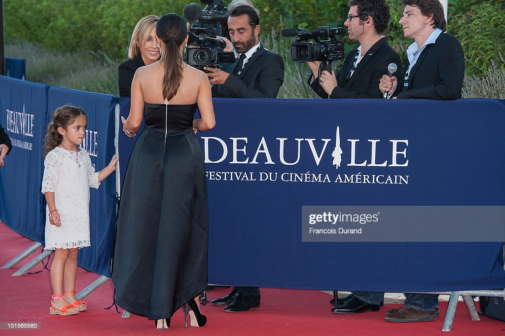Salma Hayek arrives with her daughter Valentina Paloma at the closing ceremony of the 38th Deauville American Film Festival on September 8, 2012 in Deauville, France.