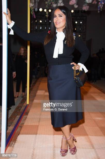 Salma Hayek attends the Alexander McQueen show as part of the Paris Fashion Week Womenswear Spring/Summer 2018 on October 2 2017 in Paris France