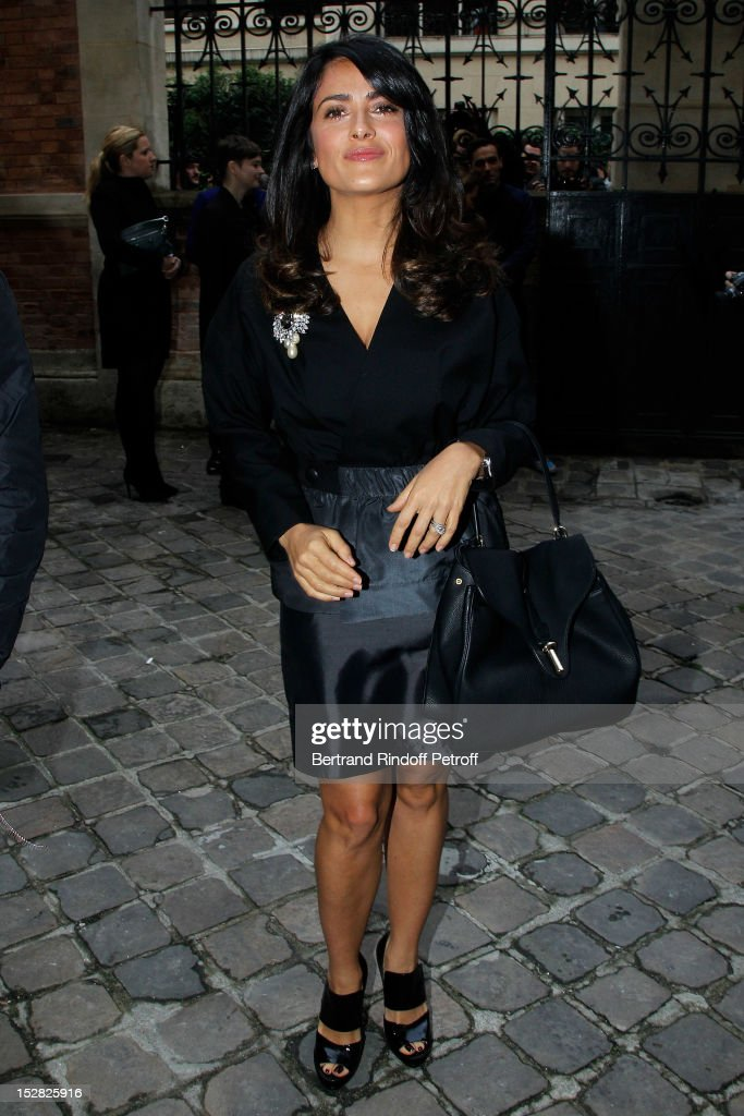 <a gi-track='captionPersonalityLinkClicked' href=/galleries/search?phrase=Salma+Hayek&family=editorial&specificpeople=201844 ng-click='$event.stopPropagation()'>Salma Hayek</a> attends the Balenciaga Spring / Summer 2013 show as part of Paris Fashion Week on September 27, 2012 in Paris, France.