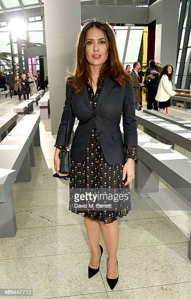 Salma Hayek attends the Christopher Kane show during London Fashion Week SS16 at Sky Garden on September 21 2015 in London England