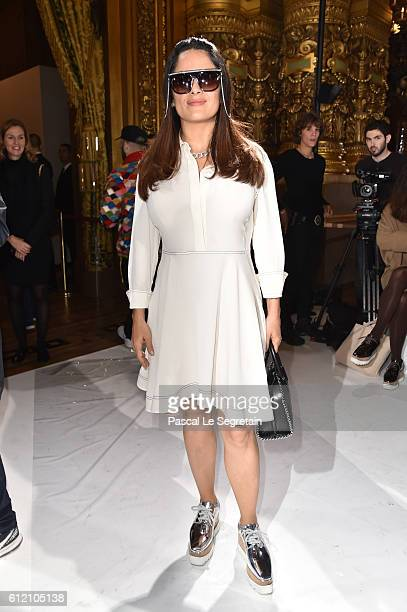 Salma Hayek attends the Stella McCartney show as part of the Paris Fashion Week Womenswear Spring/Summer 2017 on October 3 2016 in Paris France