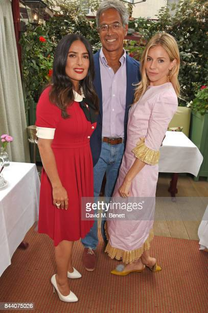 Salma Hayek Dr Mitch Besser founder of mothers2mothers and Sienna Miller attend the mothers2mothers Host Committee Breakfast at Mark's Club on...