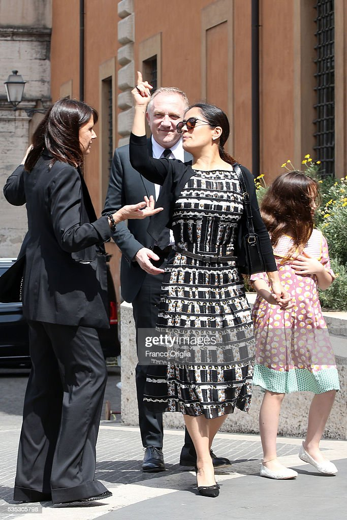 Salma Hayek, Francois-Henri Pinault and their daughter Valentina Paloma Pinault arrive at 'Un Muro o Un Ponte' Seminary held by Pope Francis at the Paul VI Hall on May 29, 2016 in Vatican City, Vatican.