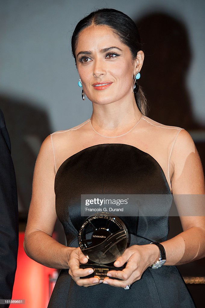 Salma Hayek holds the trophy she received as a tribute for her career during the closing ceremony of the 38th Deauville American Film Festival on September 8, 2012 in Deauville, France.