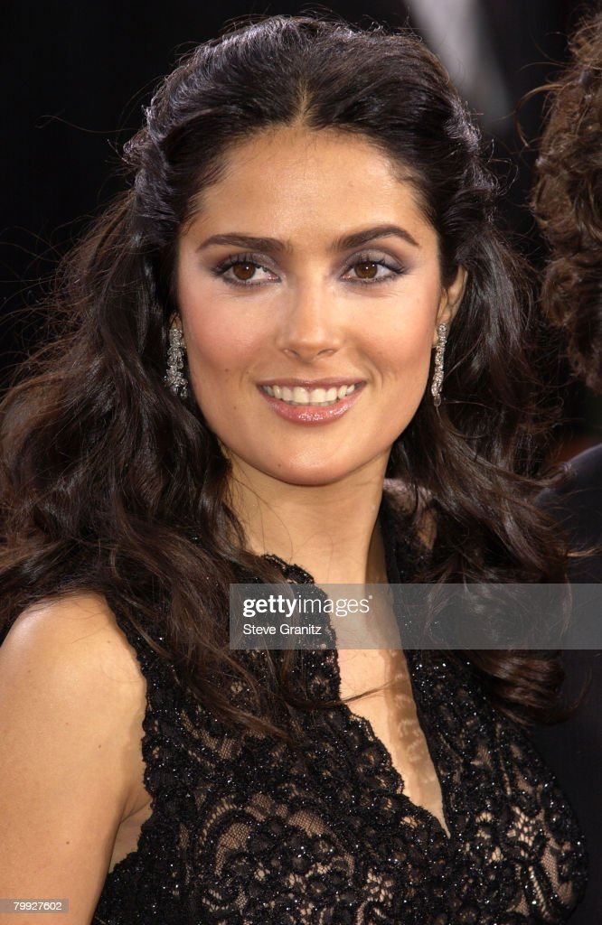 Salma Hayek in Martin Katz jewels and wearing Harry Winston earrings