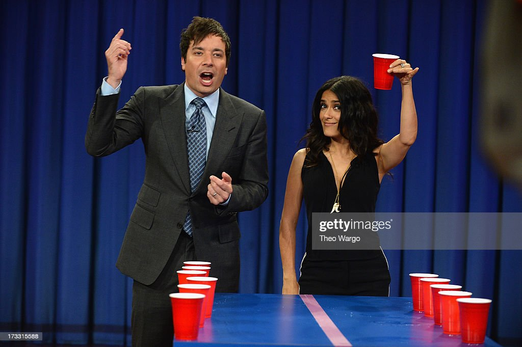 <a gi-track='captionPersonalityLinkClicked' href=/galleries/search?phrase=Salma+Hayek&family=editorial&specificpeople=201844 ng-click='$event.stopPropagation()'>Salma Hayek</a> Pinault and Jimmy Fallon during a taping of 'Late Night With Jimmy Fallon' at Rockefeller Center on July 11, 2013 in New York City.