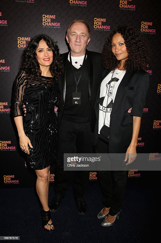 <a gi-track='captionPersonalityLinkClicked' href=/galleries/search?phrase=Salma+Hayek&family=editorial&specificpeople=201844 ng-click='$event.stopPropagation()'>Salma Hayek</a> Pinault, Francois Henri Pinault and <a gi-track='captionPersonalityLinkClicked' href=/galleries/search?phrase=Thandie+Newton&family=editorial&specificpeople=210812 ng-click='$event.stopPropagation()'>Thandie Newton</a> arrive at the Royal Box photo wall ahead of the 'Chime For Change: The Sound Of Change Live' Concert at Twickenham Stadium on June 1, 2013 in London, England. Chime For Change is a global campaign for girls' and women's empowerment founded by Gucci with a founding committee comprised of Gucci Creative Director Frida Giannini, <a gi-track='captionPersonalityLinkClicked' href=/galleries/search?phrase=Salma+Hayek&family=editorial&specificpeople=201844 ng-click='$event.stopPropagation()'>Salma Hayek</a> Pinault and Beyonce Knowles-Carter.