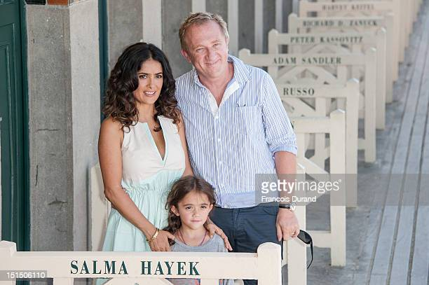 Salma Hayek poses her husband FrancoisHenri Pinault with their daughter Valentina Paloma Pinault as she unveiled the beach locker room dedicated to...