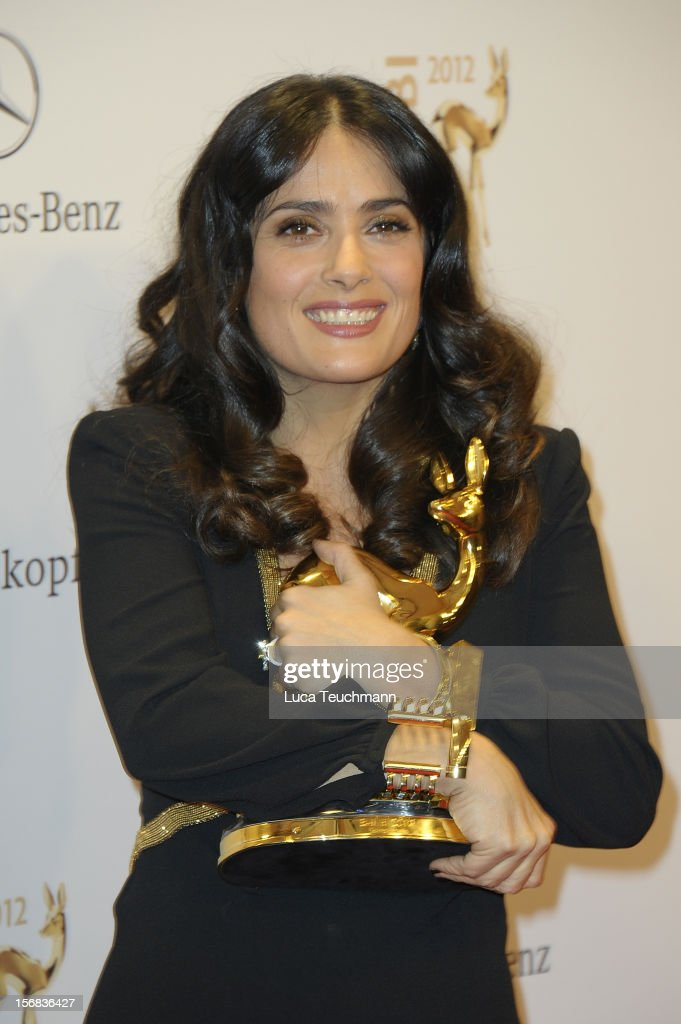 <a gi-track='captionPersonalityLinkClicked' href=/galleries/search?phrase=Salma+Hayek&family=editorial&specificpeople=201844 ng-click='$event.stopPropagation()'>Salma Hayek</a> poses in front of the winners board during the 'BAMBI Awards 2012' at the Stadthalle Duesseldorf on November 22, 2012 in Duesseldorf, Germany.
