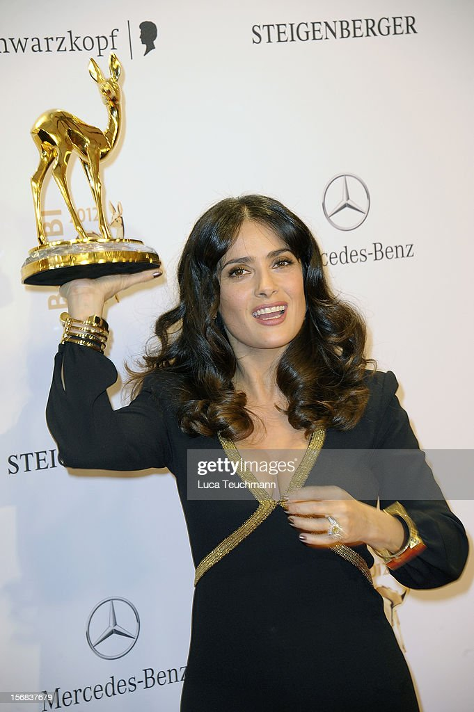 Salma Hayek poses in front of the winners board during the 'BAMBI Awards 2012' at the Stadthalle Duesseldorf on November 22, 2012 in Duesseldorf, Germany.