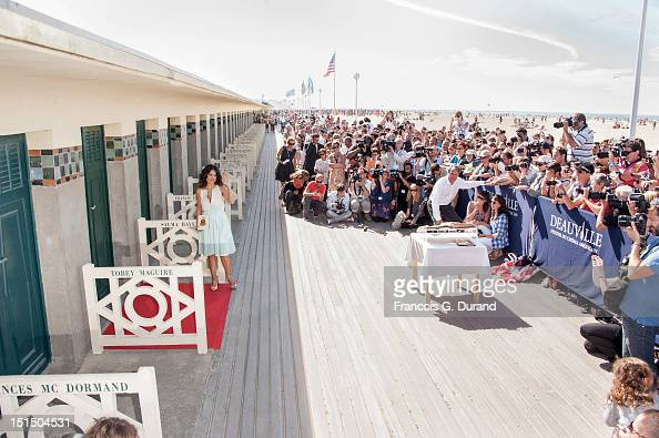 Salma Hayek poses next to the beach closet dedicated to her on the Promenade des Planches for the movie 'Savages' during the 38th Deauville American...