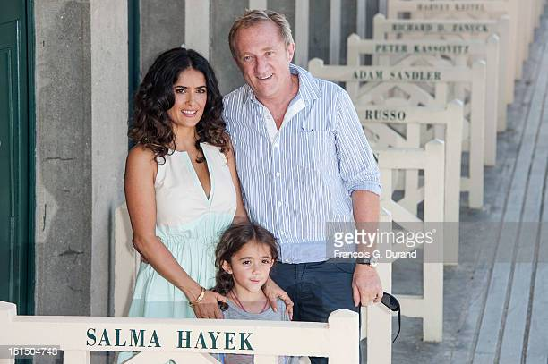 Salma Hayek poses with her daughter Valentina Paloma Pinault and her husband FrancoisHenri Pinault after unveiling the beach closet dedicated to her...