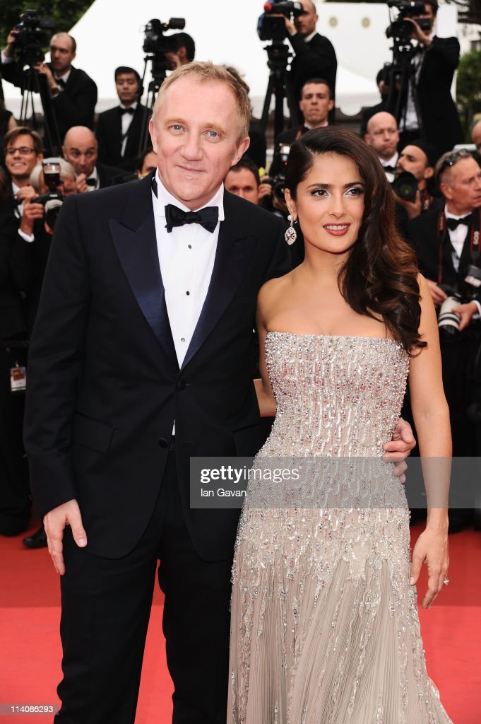 <a gi-track='captionPersonalityLinkClicked' href=/galleries/search?phrase=Salma+Hayek&family=editorial&specificpeople=201844 ng-click='$event.stopPropagation()'>Salma Hayek</a> (R) poses with her husband <a gi-track='captionPersonalityLinkClicked' href=/galleries/search?phrase=Francois-Henri+Pinault&family=editorial&specificpeople=532174 ng-click='$event.stopPropagation()'>Francois-Henri Pinault</a> as they attend the Opening Ceremony at the Palais des Festivals during the 64th Cannes Film Festival on May 11, 2011 in Cannes, France.