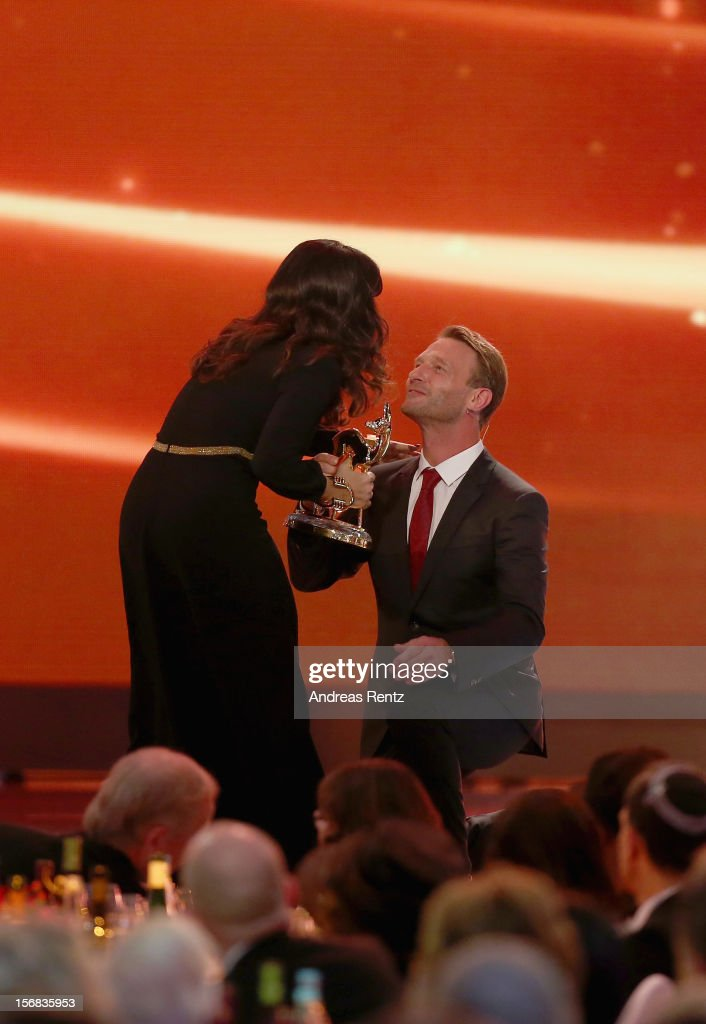 Salma Hayek receives the Bambi Award 'Actress International' from Thomas Kretschmann during the 'BAMBI Awards 2012' at the Stadthalle Duesseldorf on November 22, 2012 in Duesseldorf, Germany.