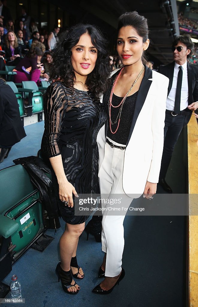 Salma Hayek-Pinault (L) and Freida Pinto pose inside the Royal Box at the 'Chime For Change: The Sound Of Change Live' Concert at Twickenham Stadium on June 1, 2013 in London, England. Chime For Change is a global campaign for girls' and women's empowerment founded by Gucci with a founding committee comprised of Gucci Creative Director Frida Giannini, Salma Hayek Pinault and Beyonce Knowles-Carter.